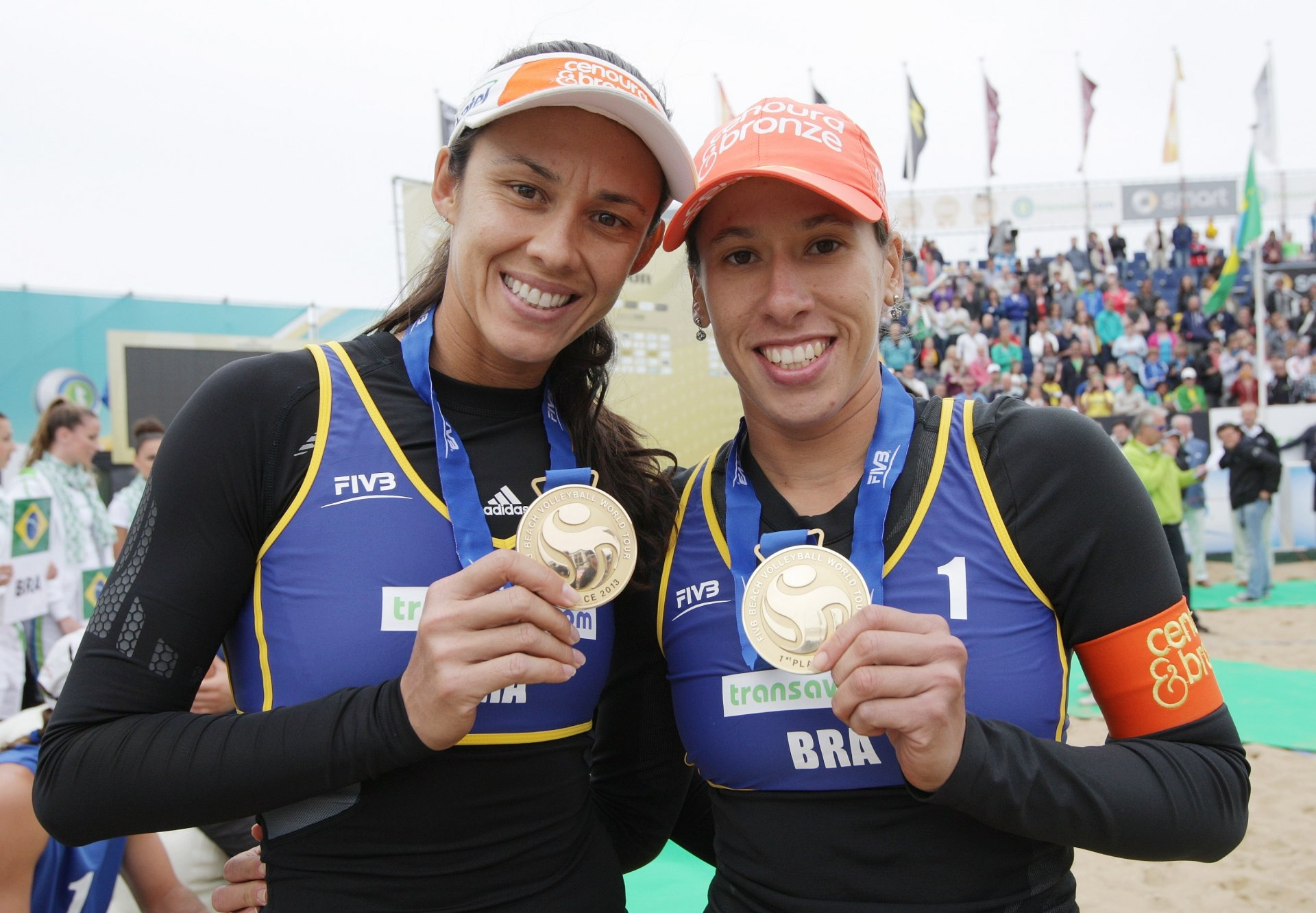 Talita and Taiana pose with one of the five gold medals the won together between 2013 and 2014 (Photocredit: FIVB)