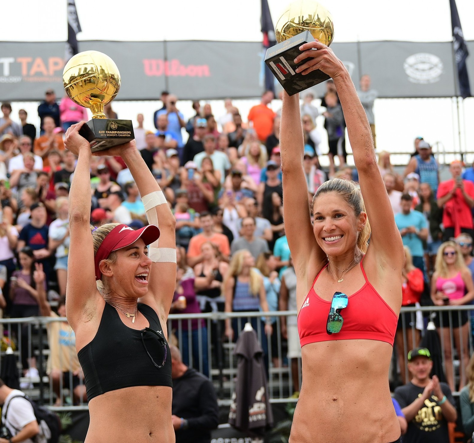 April and Alix lift the AVP trophies in Chicago (Photocredit: AVP)