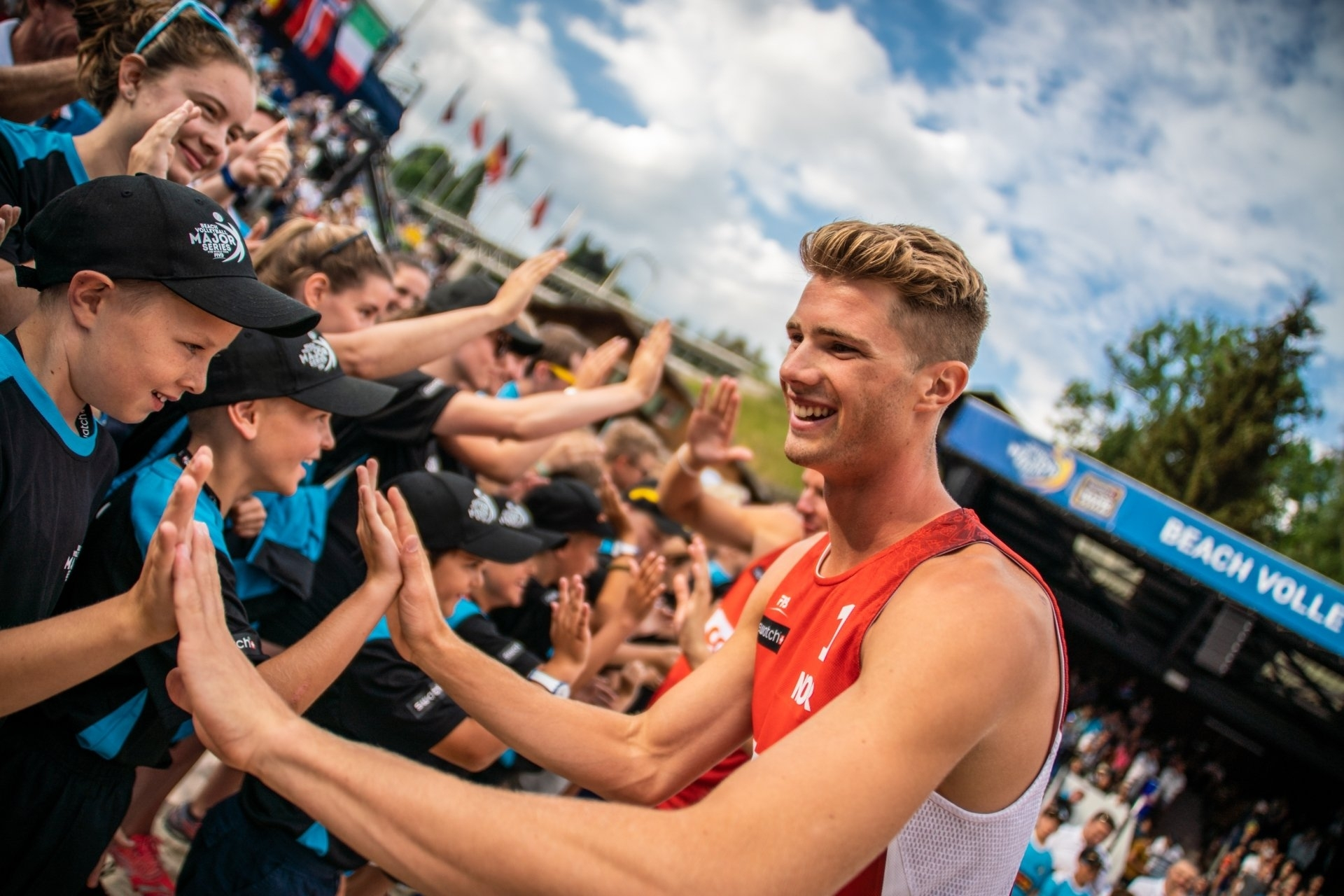 Anders Mol high-fives volunteers after winning his first Major gold in Gstaad in 2018