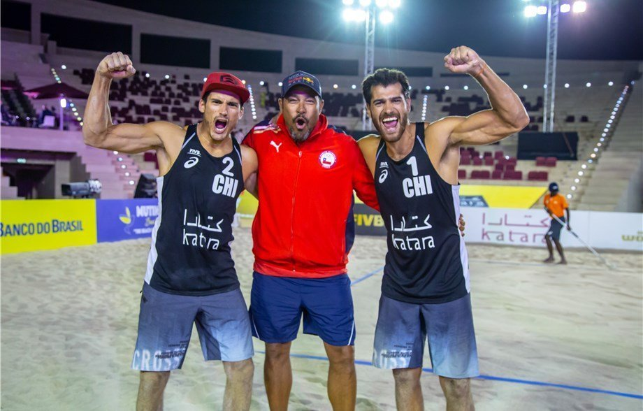 Estaban and Marco celebrate a second gold in the space of a week with Brazilian coach Paulao. Photo: FIVB