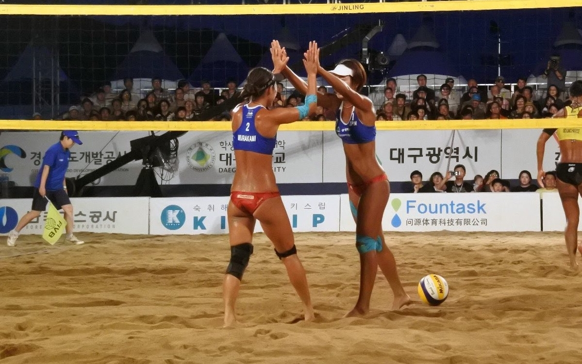 Miki and Megumi celebrate during their gold medal victory in Korea. Photocredit: FIVB