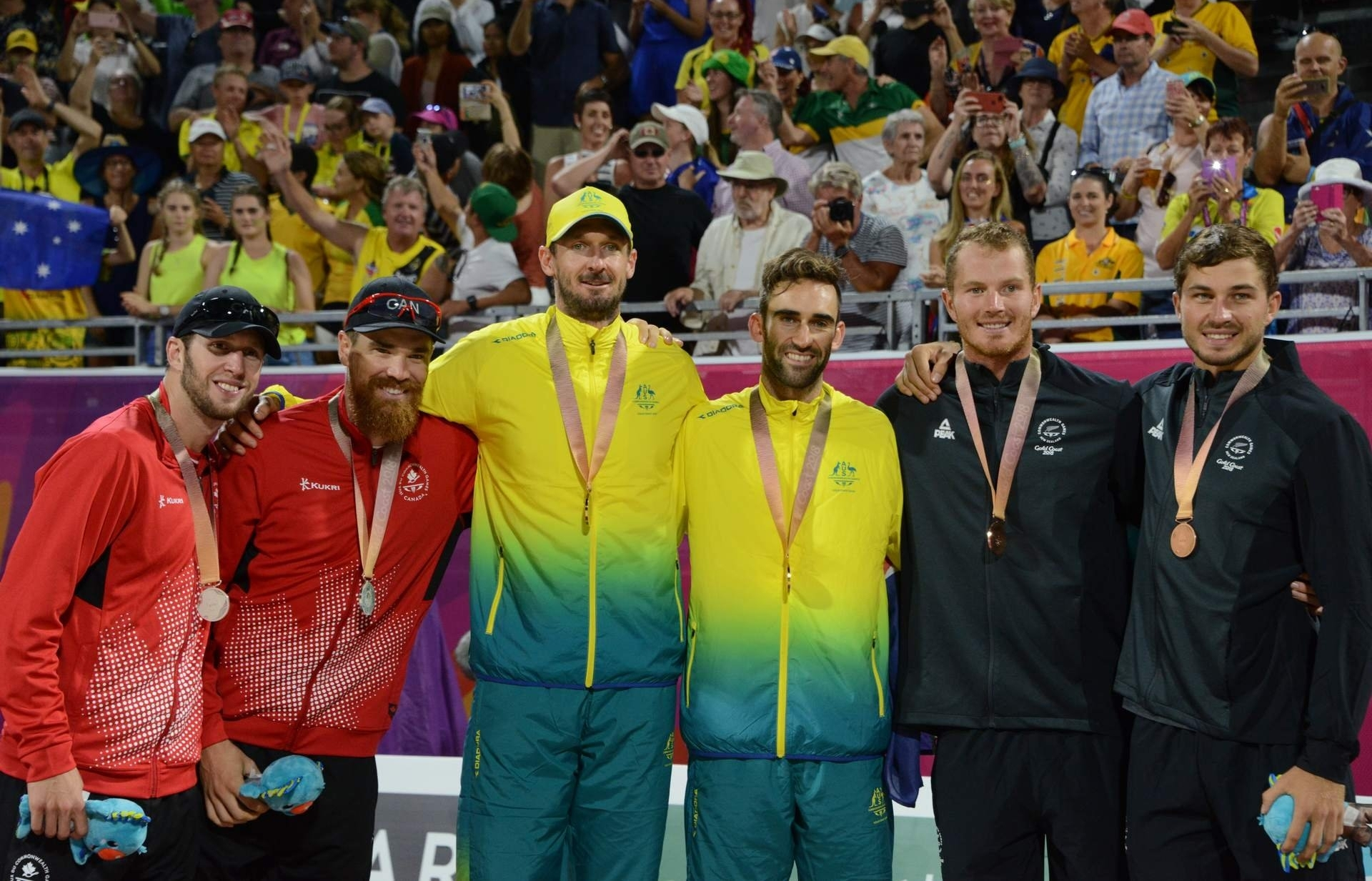 The medalists pose at the awards ceremony. Photocredit: Beach Major Series