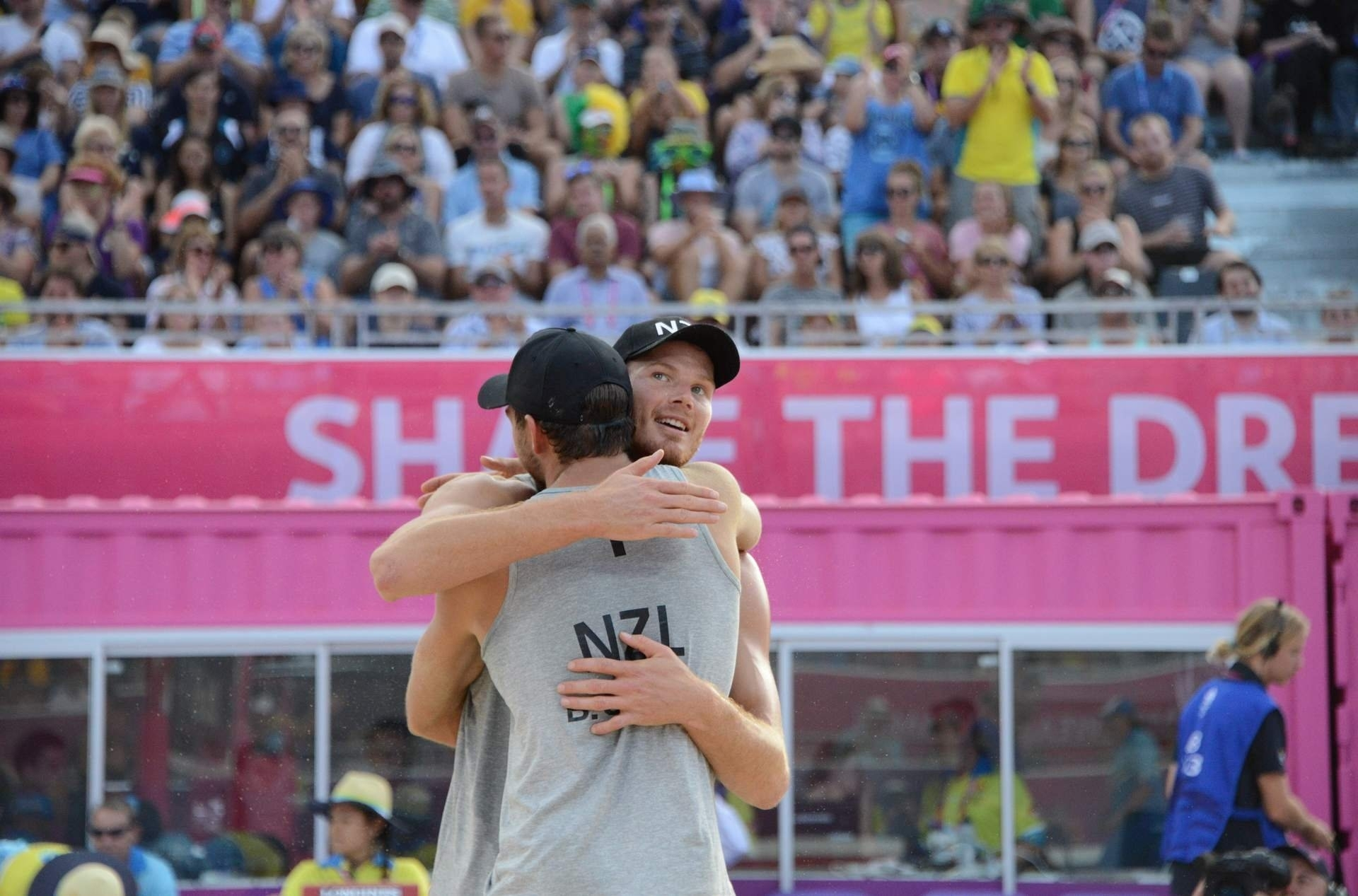 Sam (facing the camera) and Ben celebrate winning bronze at the Commonwealth Games. Photocredit: Beach Major Series
