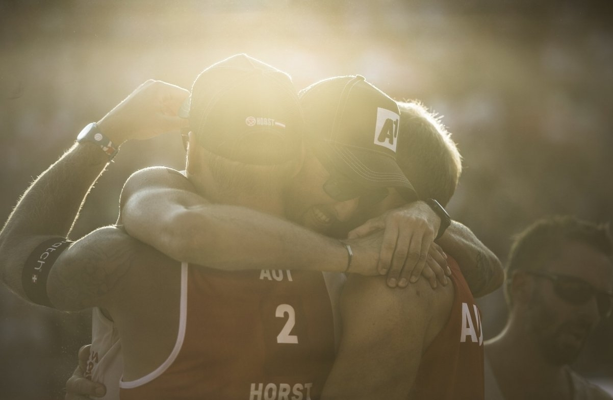 Clemens Doppler and Alex Horst embrace coach Robert Nowotny (right) during last year's World Championships in Vienna