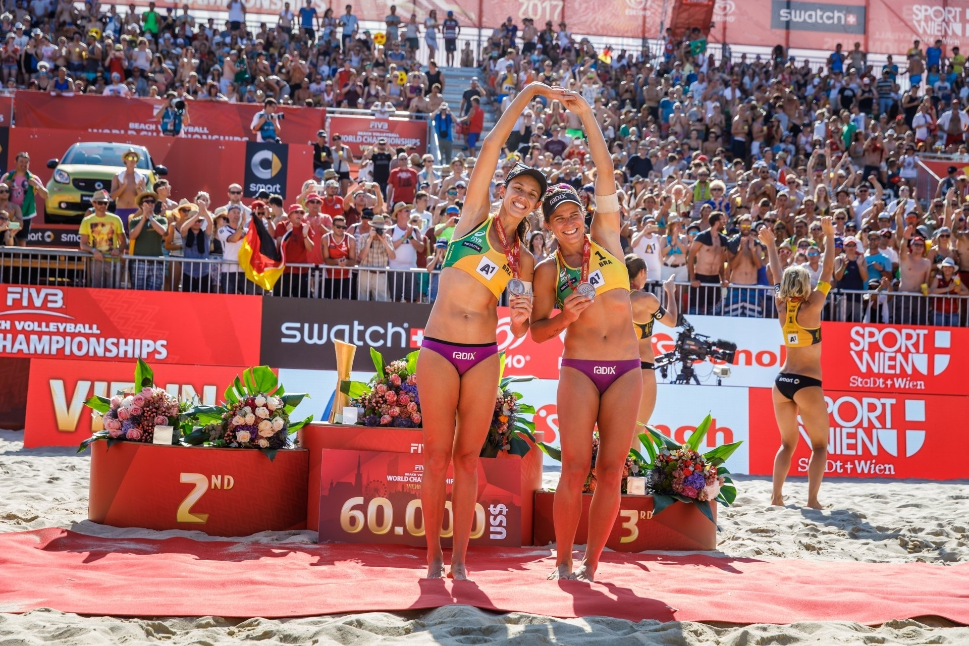 Larissa and Talita celebrate their bronze medal at the World Championships in Vienna.