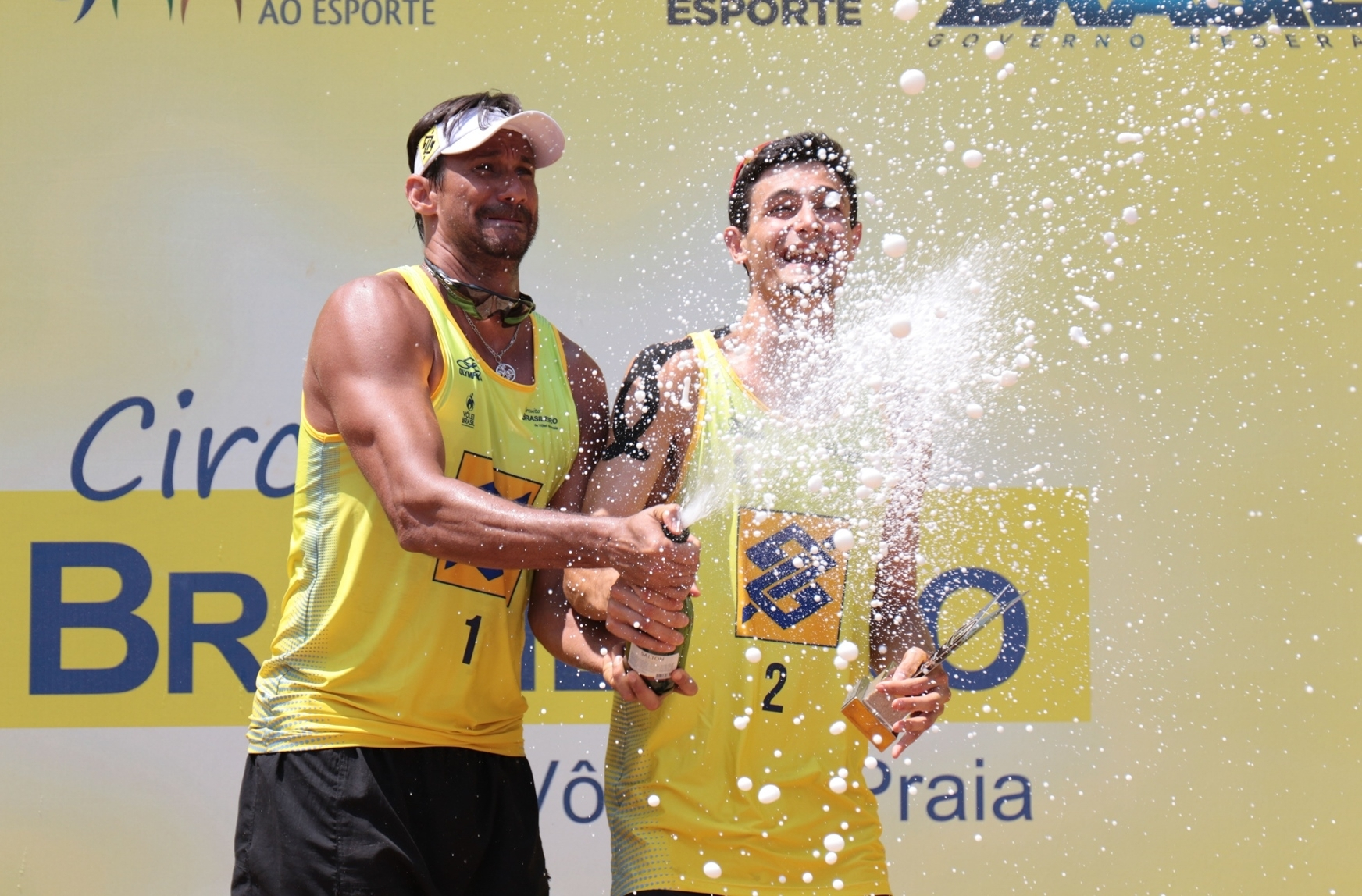 Ricardo and Andre celebrate with champagne! Photocredit: FIVB