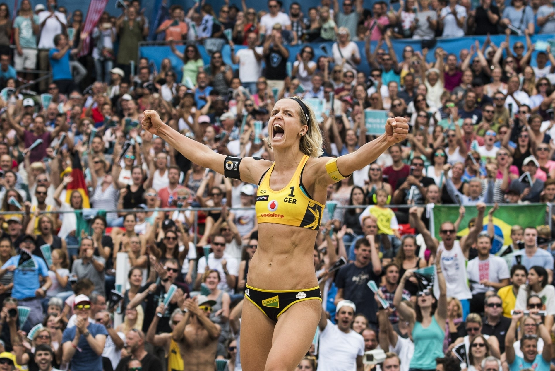 Laura Ludwig celebrates in Hamburg after she and Kira Walkenhorst won gold at the World Tour Finals
