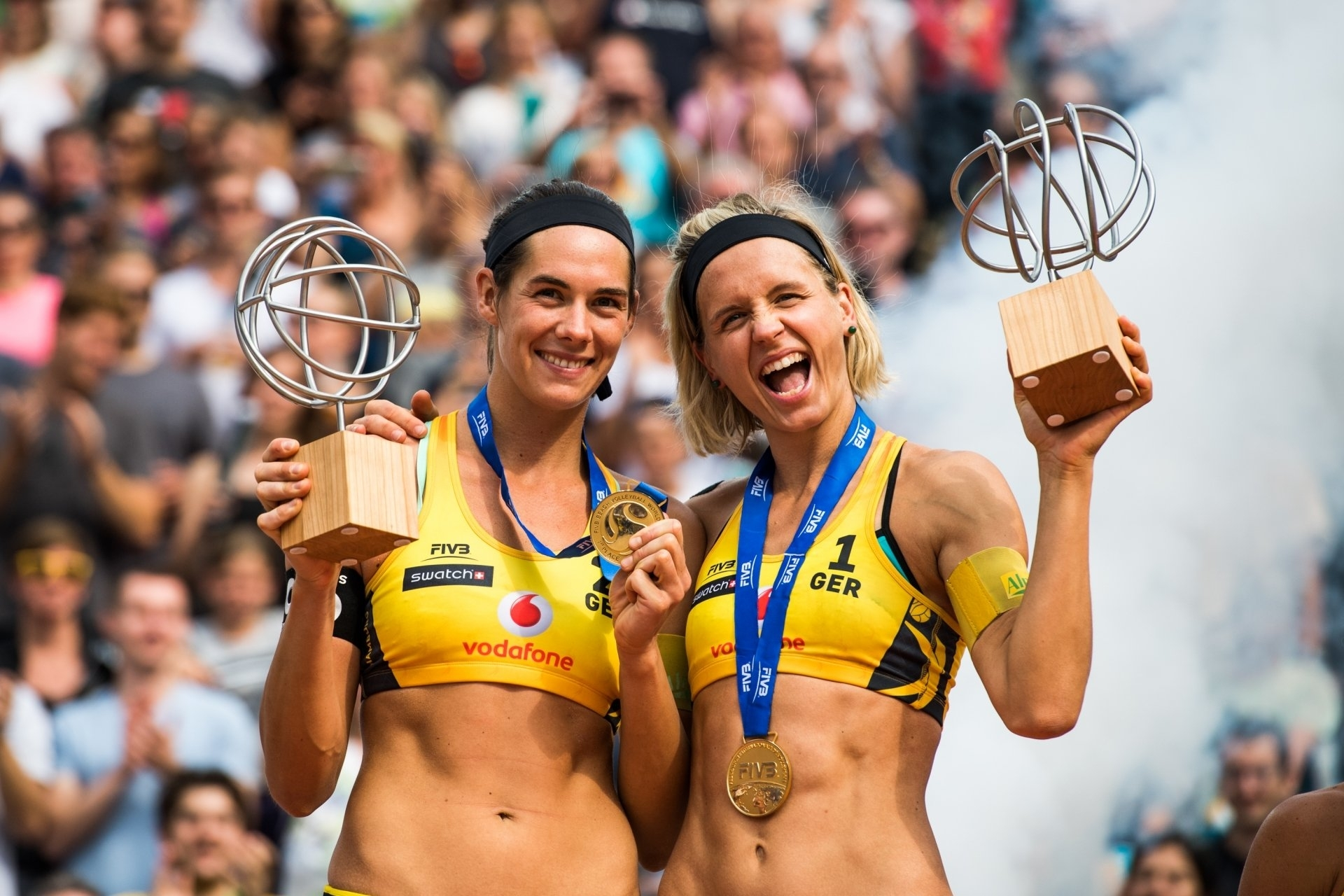 Kira (left) and Laura celebrate winning the World Tour Finals in Hamburg this year
