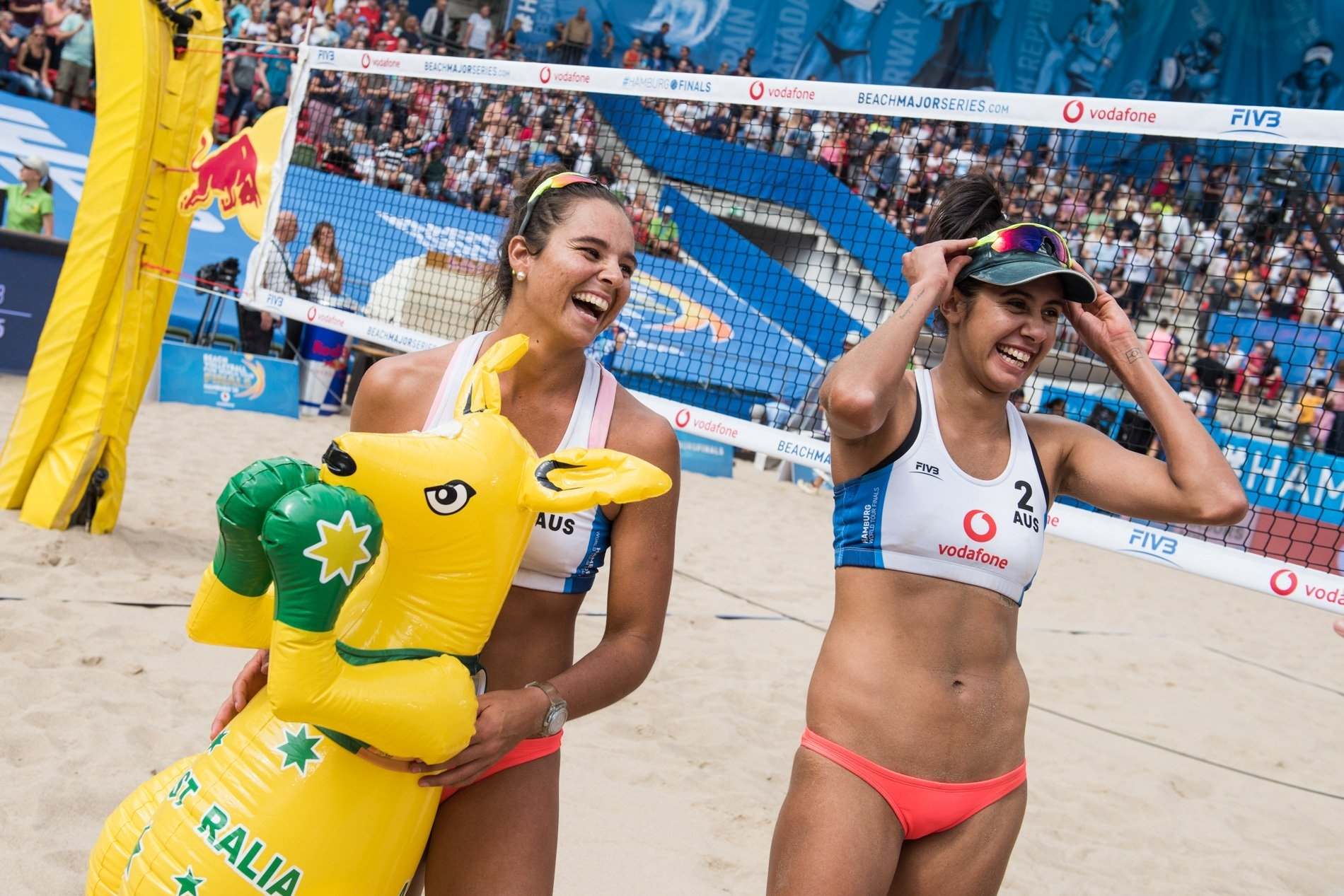 Mariafe (left) and Taliqua celebrate at the end of their bronze medal match victory in Hamburg
