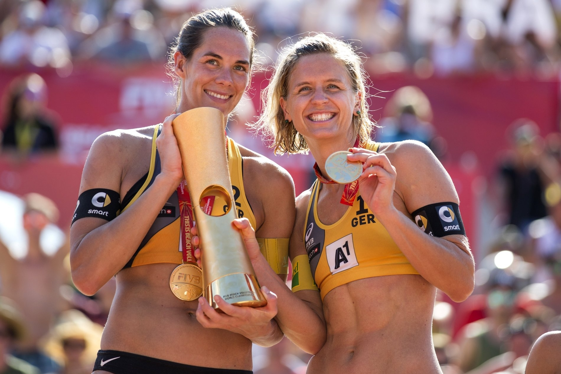 Kira (left) and Laura all smiles after taking World Championship gold in Vienna last summer