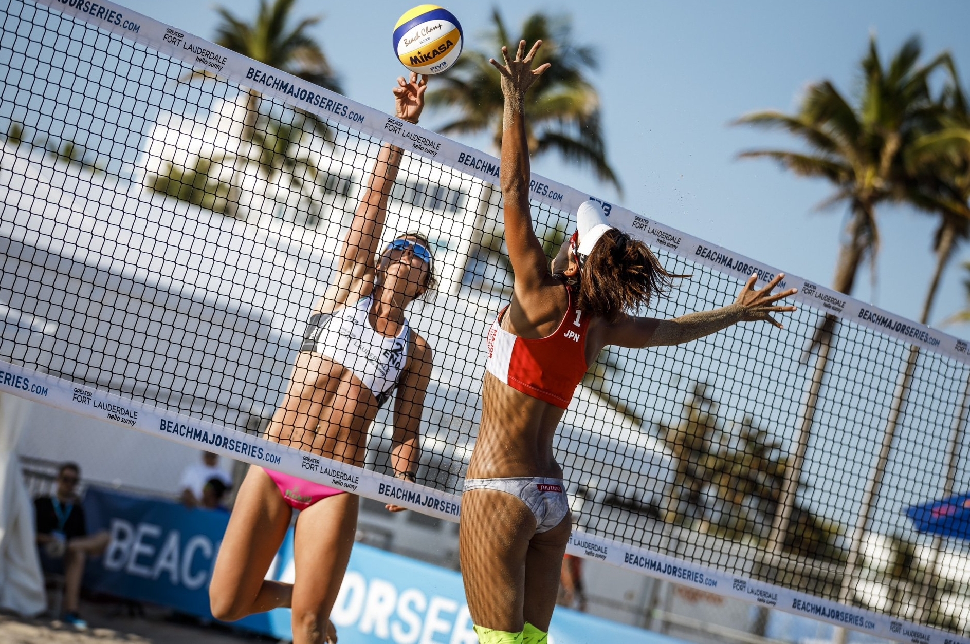 Jessica (left) in action at the net against Japan at the Fort Lauderdale Major
