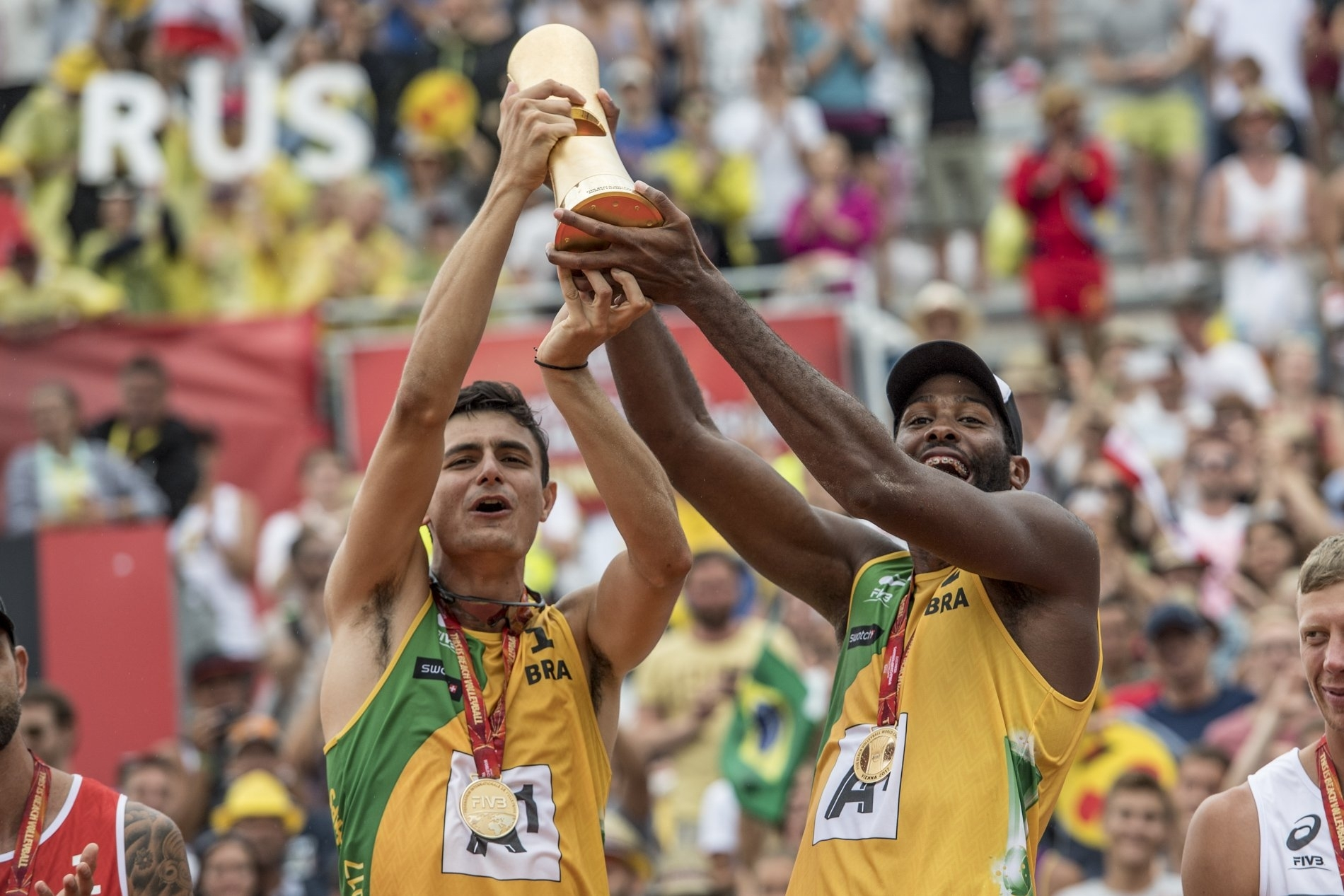 Evandro (right) and Andre lift the World Championship trophy in Vienna