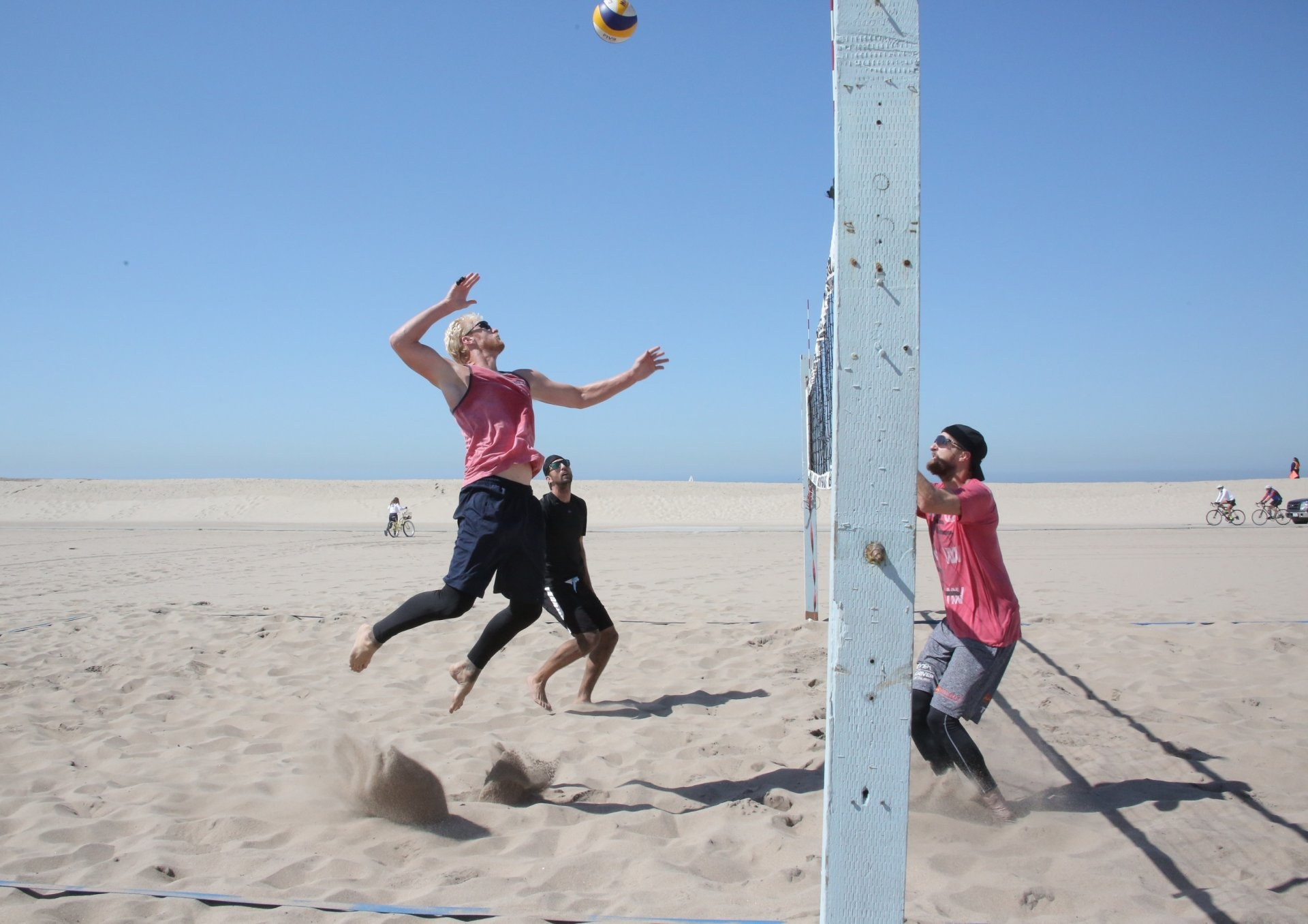Budinger (spiking, left) and Rosenthal in a training session with Theo Brunner in Hermosa Beach