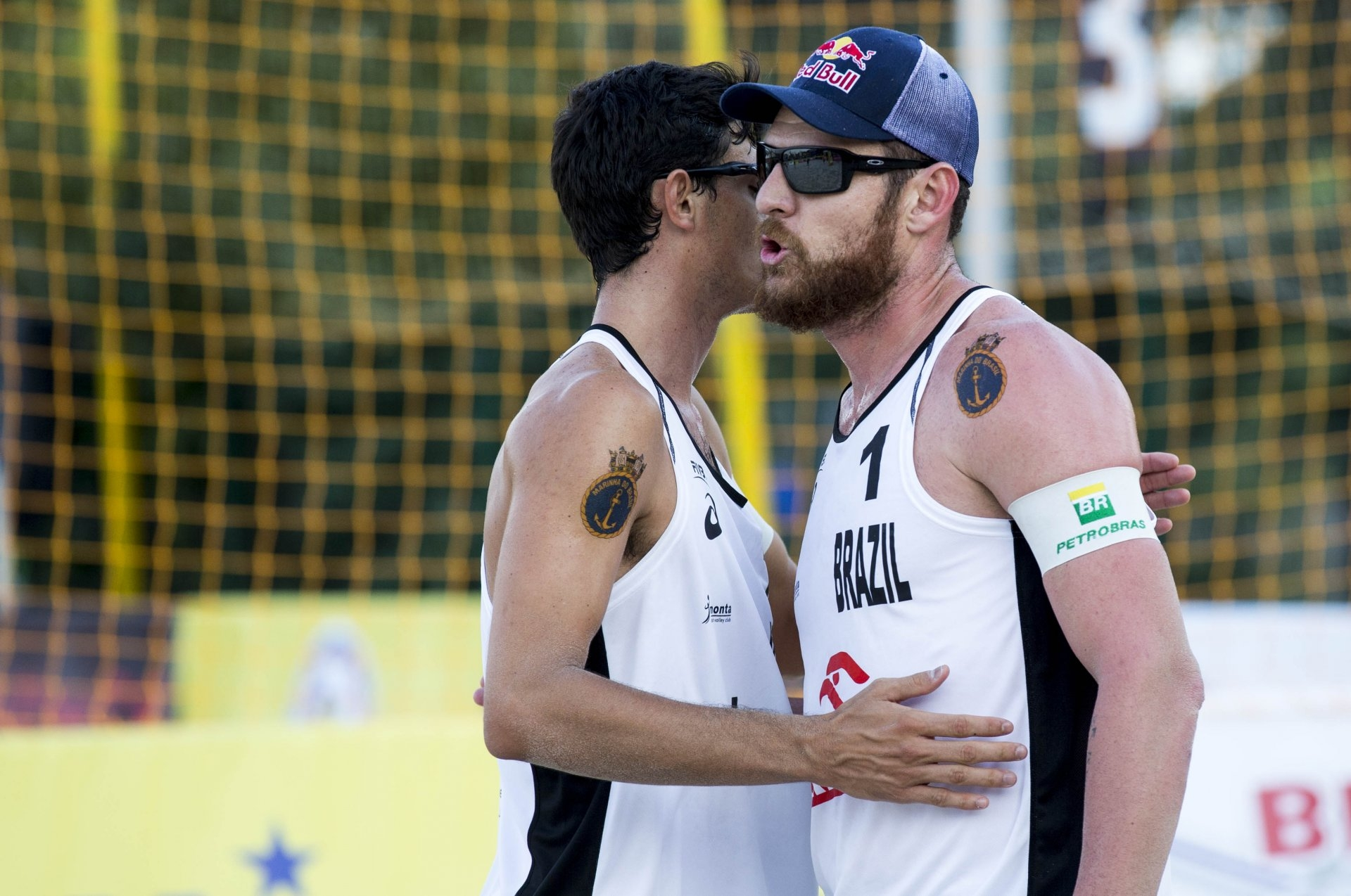 Alison and Andre celebrate their victory over Bruno and Pedro in Warsaw (Photocredit: FIVB)